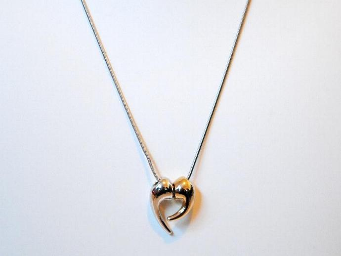 2 half hearts Gold and Silver Pendant on a chain