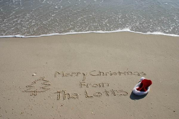 Personalized Christmas Beach Writings with a Santa Hat