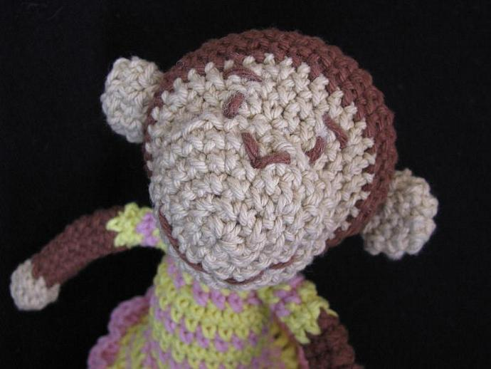 Cotton toy girl monkey. Mia with yellow and pink striped dress