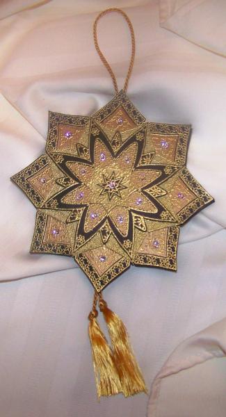 Mandala in black, copper, and gold