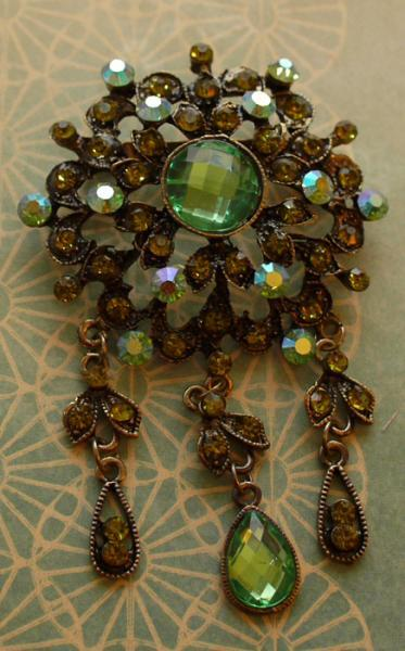 Green rhinestone brooch