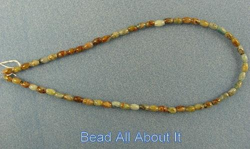 Crazy Lace Agate 7x4mm barrel beads strand