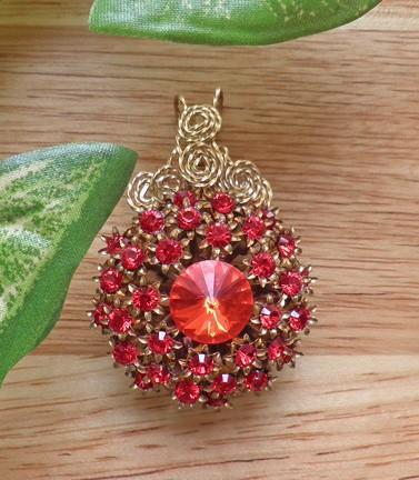 Vintage pendant encrusted with red Swarovski crystals gold filled  P57