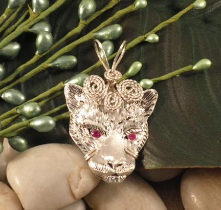 Sterling silver detailed cat face pendant with ruby eyes   P217