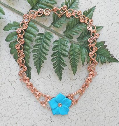 Copper lacy double swirl wire bib necklace with carved turquoise flower
