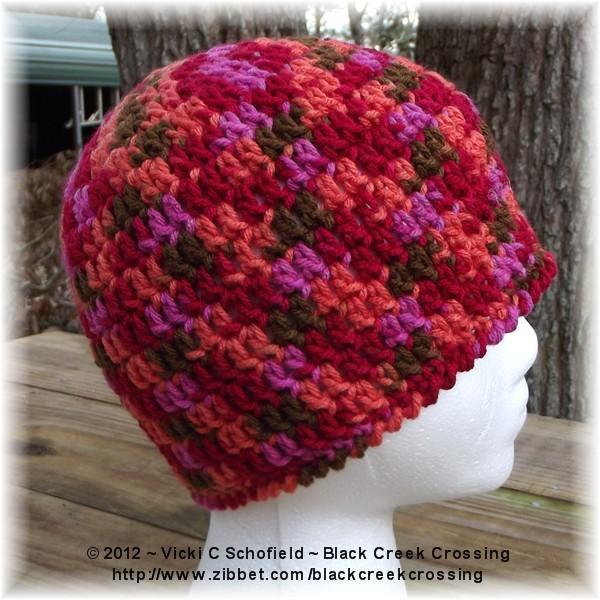 Crocheted Ponytail Hat Orange Pink Red