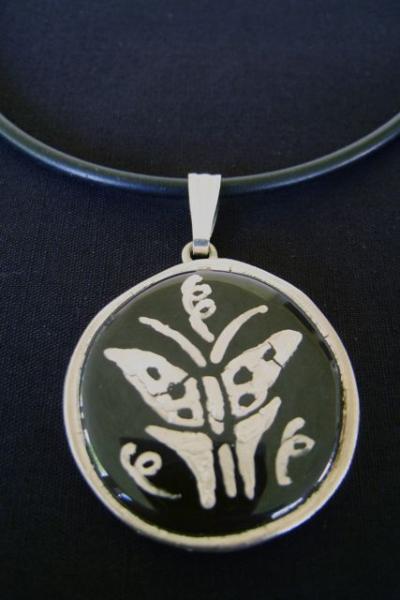 Silver Butterfly on Black Porcelain