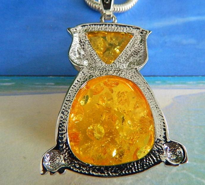 Vintage  pressed  amber  owl  pendant  on  long  chain