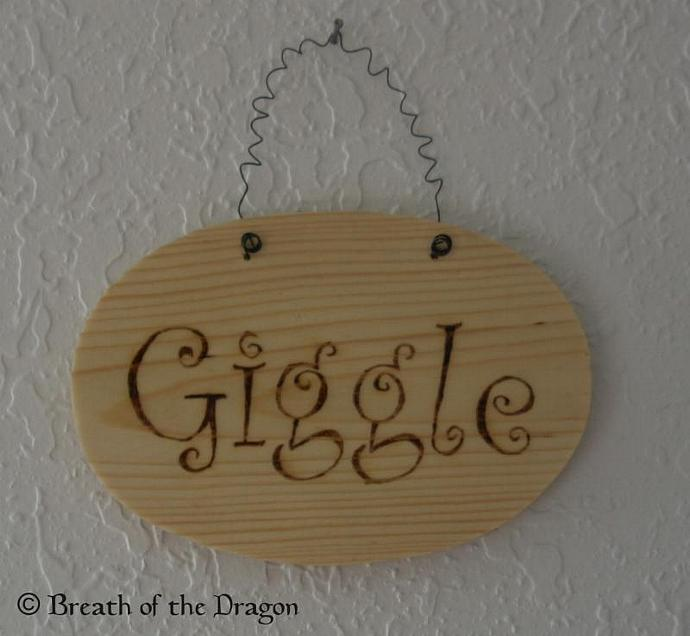 Giggle plaque