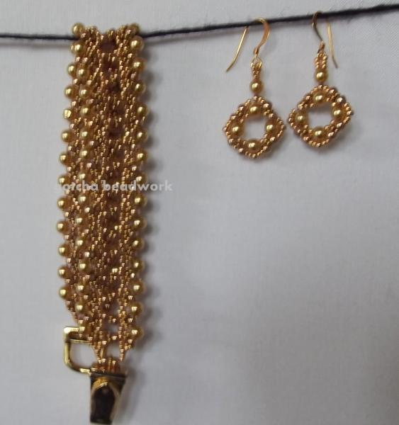 gold colored set  earrings and bracelet