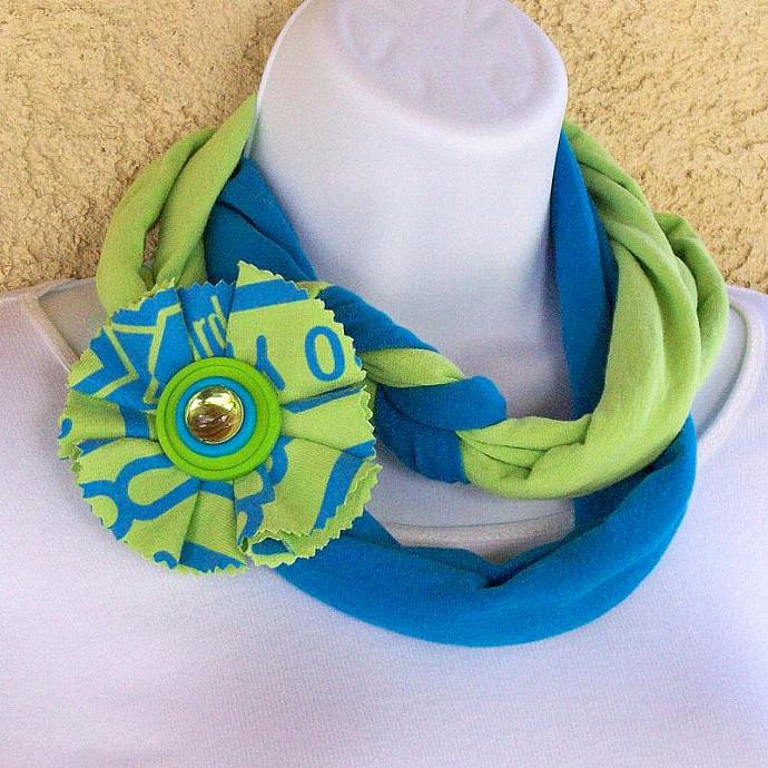 Infinity Scarf in bright green and blue jersey knit, with matching pin