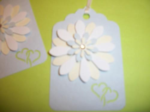 Light blue textured hang tag with a 3D paper layered Flower / and heart cut out
