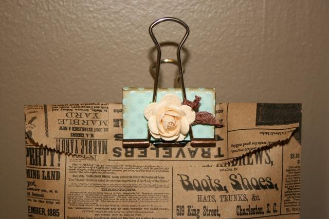 100 used Giant Binder clips make seating card holders for wedding baby shower