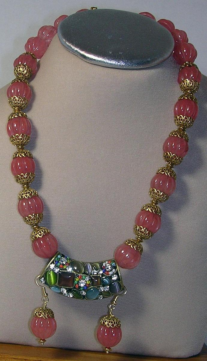Pink Quartz Carved Beads statement necklace with a large exotic gold color