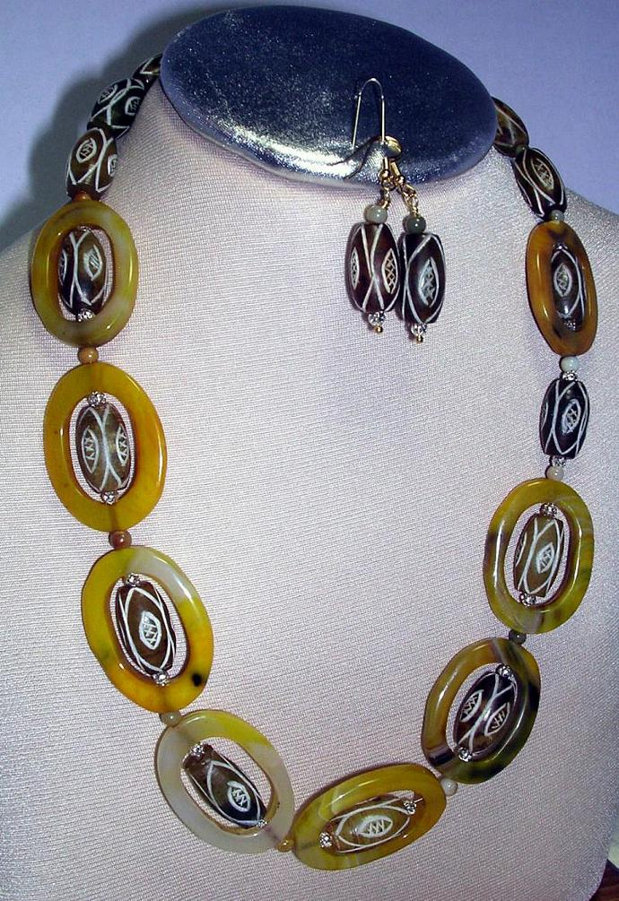 Bead within a Bead design of carved natural opaque agate -  Beads with a Pupa