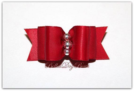 5/8 Red Double Loop Show Bow with Flags. Three Silver Beads are centered.