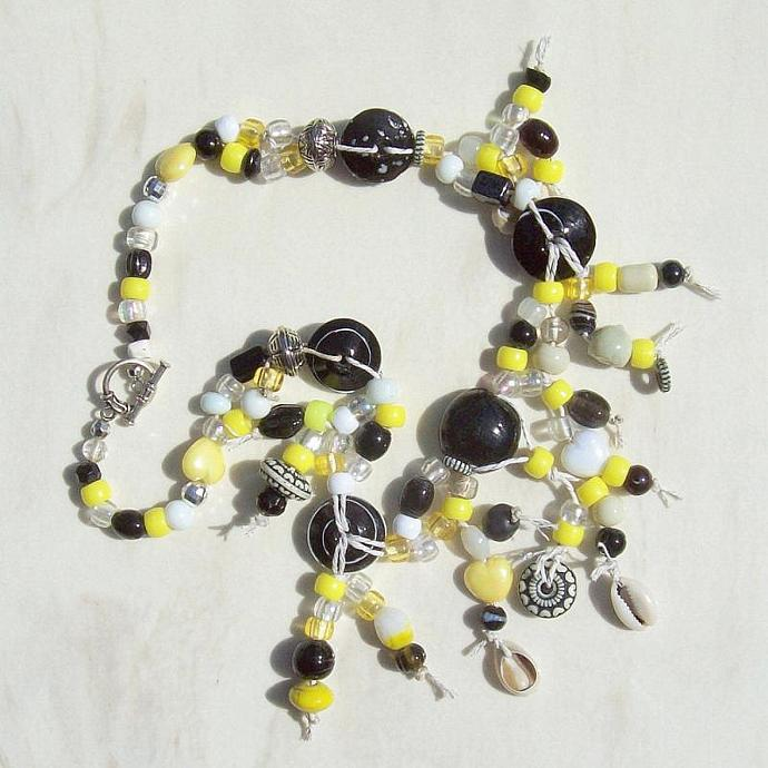 Statement Necklace, ethnic-inspired with black, white and yellow beads tied on