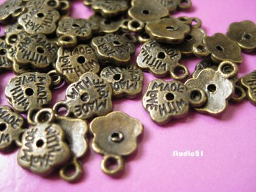40 pcs of Antique Bronze Finish Flower Made with Love Charm