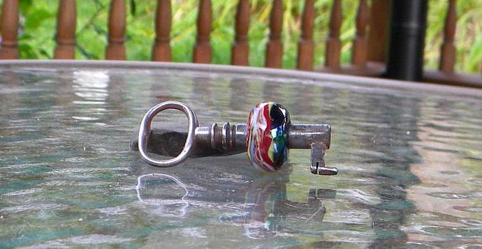 Vintage skeleton key with lampwork bead
