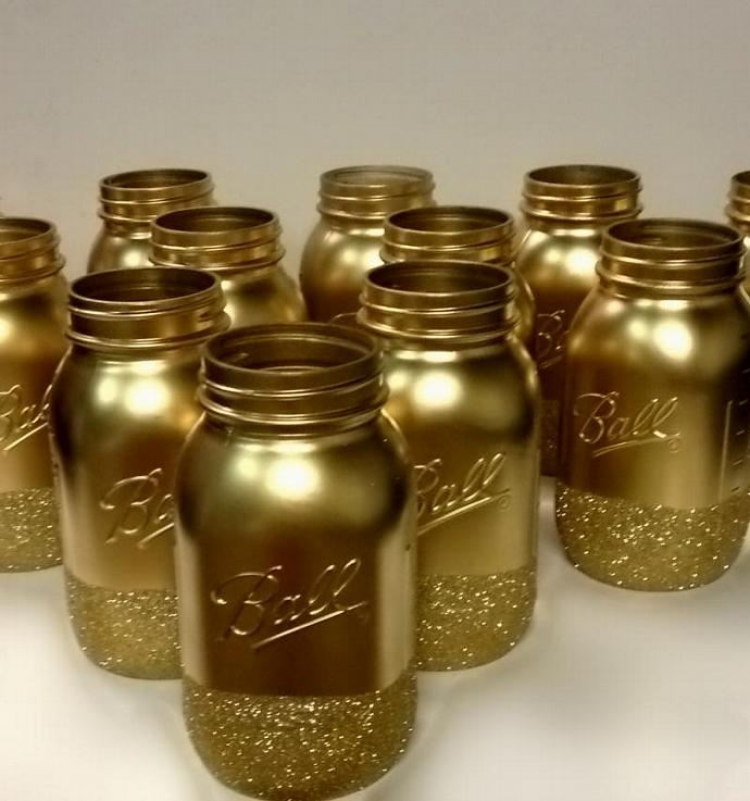 Gold and glitter mason jar wedding centerpiece by