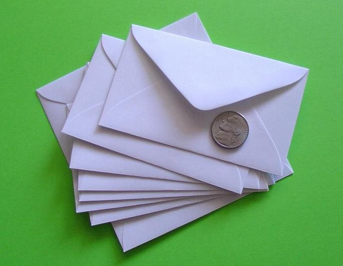 50 mini white envelopes for gift enclosures and biz cards