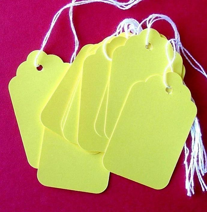 50 bright yellow scalloped paper tags with string