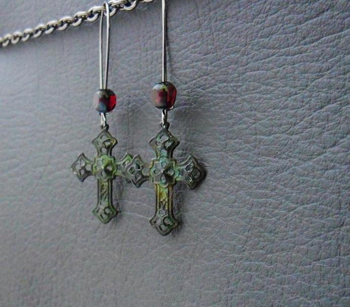 Blood In A Graveyard earrings: distressed verdigris crosses with blood-red glass