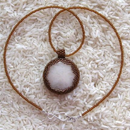 Pendant necklace snow quartz with bronze beadwork