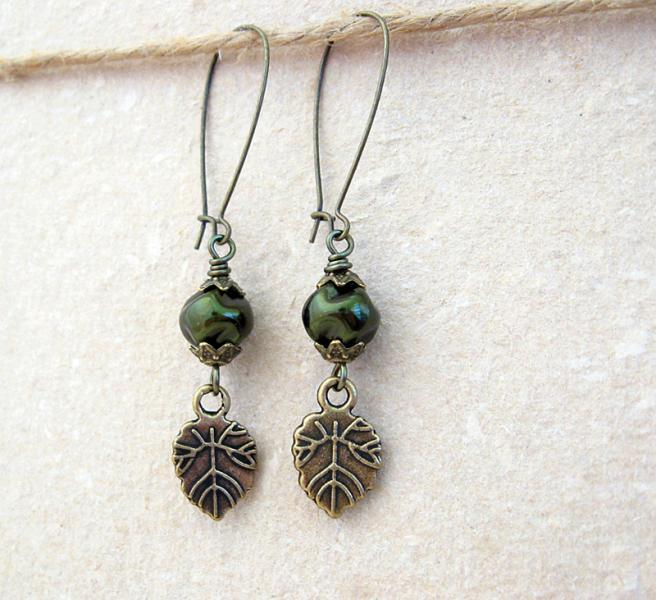 Nettle earrings: dark green glass pearls with bronze leaf charms