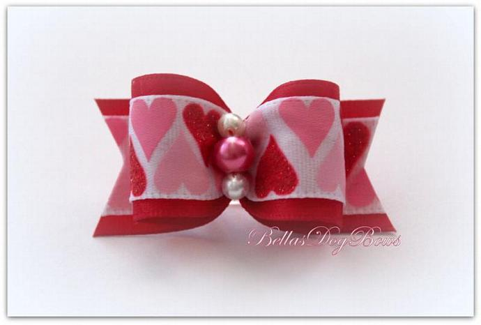 """7/8"""" Valentines Day Bow. Red Satin with Pink Rose Pearl embraced by two White"""