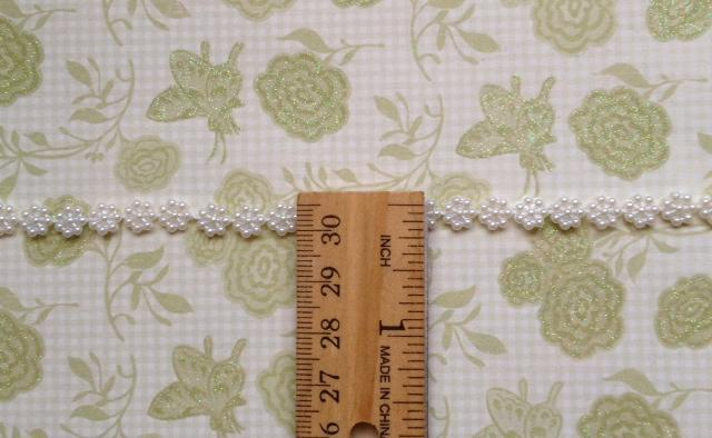 2 yds. Small Flower Flatback Pearl String Width 7mm. White (Item# FPS-03)