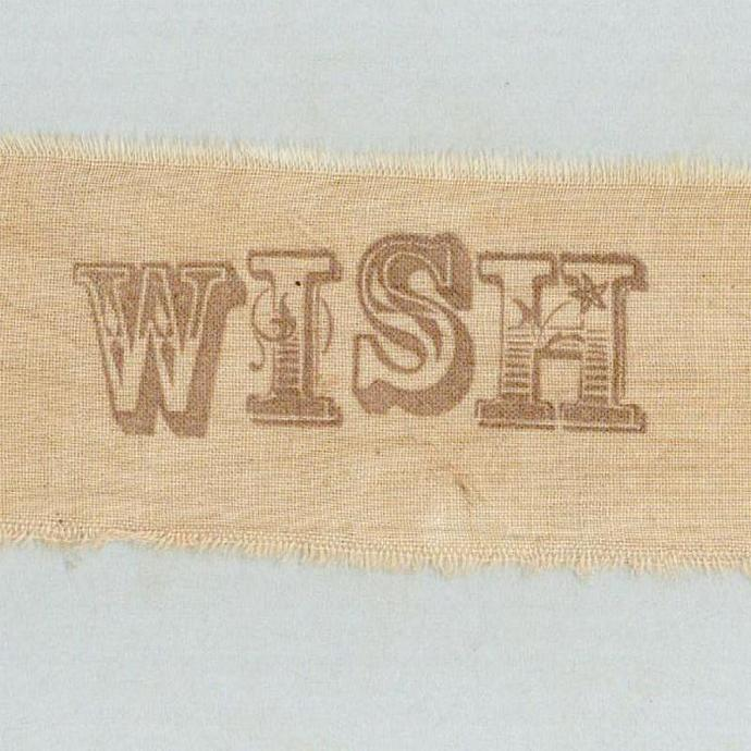 WISH   vintage, worn hand made tea dyed muslin rubber stamped ribbon 1.5 wide