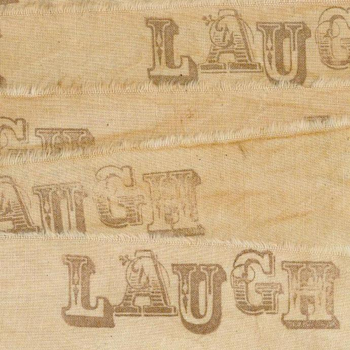 LAUGH,  vintage, worn hand made tea dyed muslin rubber stamped ribbon 1.5 wide