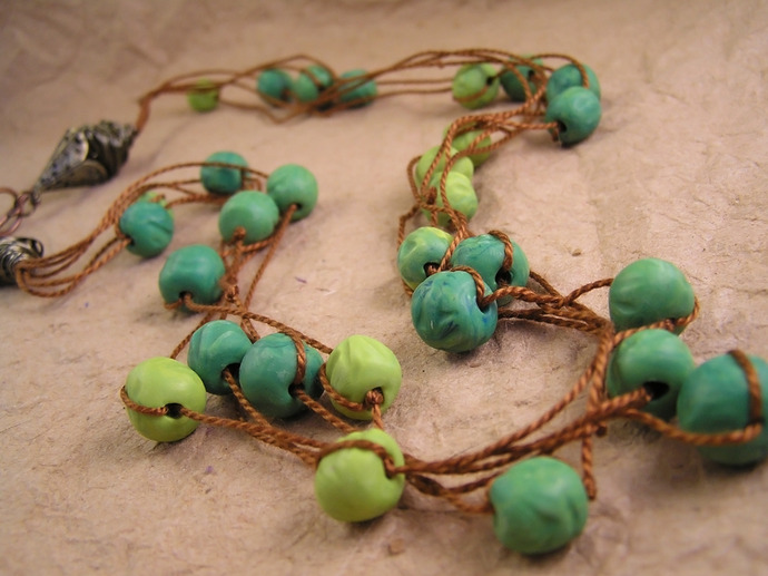 Green clay bead necklace with handmade beads on cotton cord