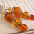 Orange glass dangle earrings. with Tibetan silver daisy spacers