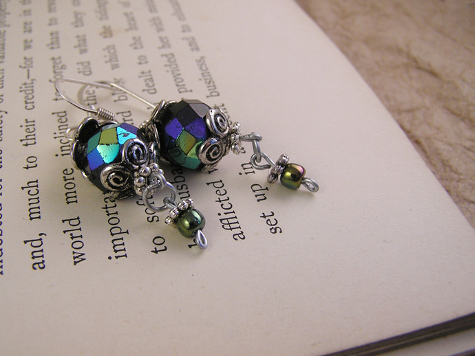 Black antiqued glass earrings with silver tone beadcaps and metallic beads