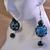 Blue and black swirl glass bead earrings