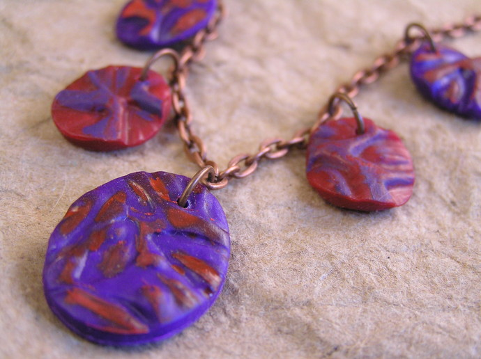 Red and purple oval necklace with handmade polyclay beads
