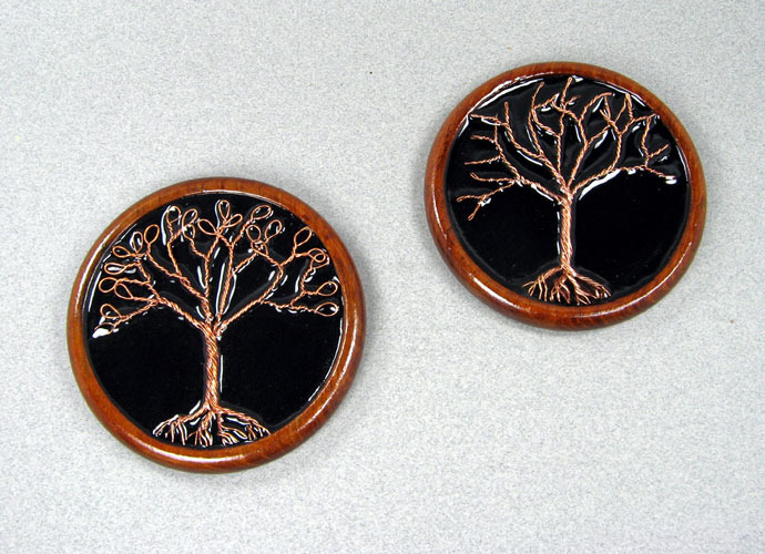 Two decorative wall plaques with twisted wire trees