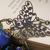 Beaded blue glass 3 strand statement necklace with copper filigree butterflies