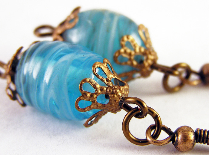 Blue swirl glass  earrings with copper details