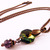 Rainbow colored crystal necklace with purple pendant bead on copper chain
