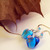 Clear blue lampwork glass heart earrings with roses
