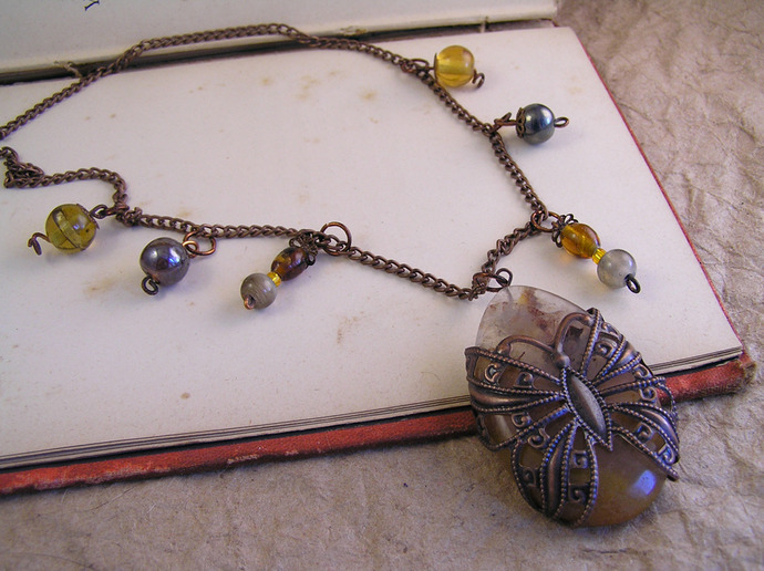 Butterfly filigree necklace with agate stone, glass beads, and copper chain