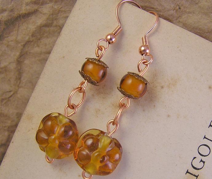 Orange glass flower dangle earrings with copper