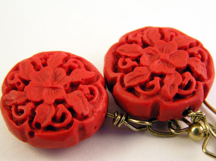 Red cinnabar earrings with floral carvings and brass earwires