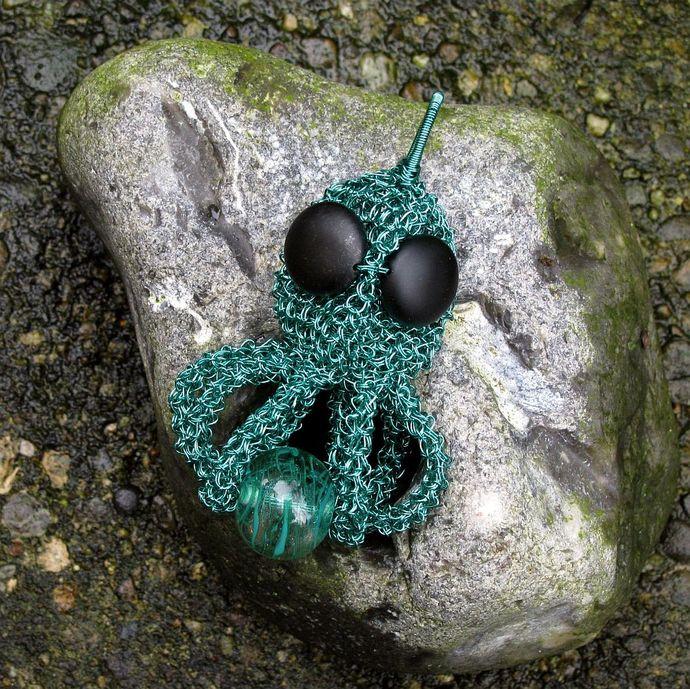 Wire crochet deepwater octopus pendant with lampwork - Hanging on Hank