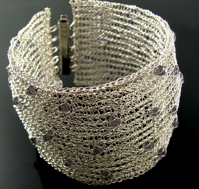 Wide silver tone wire knit cuff with tanzanite crystals