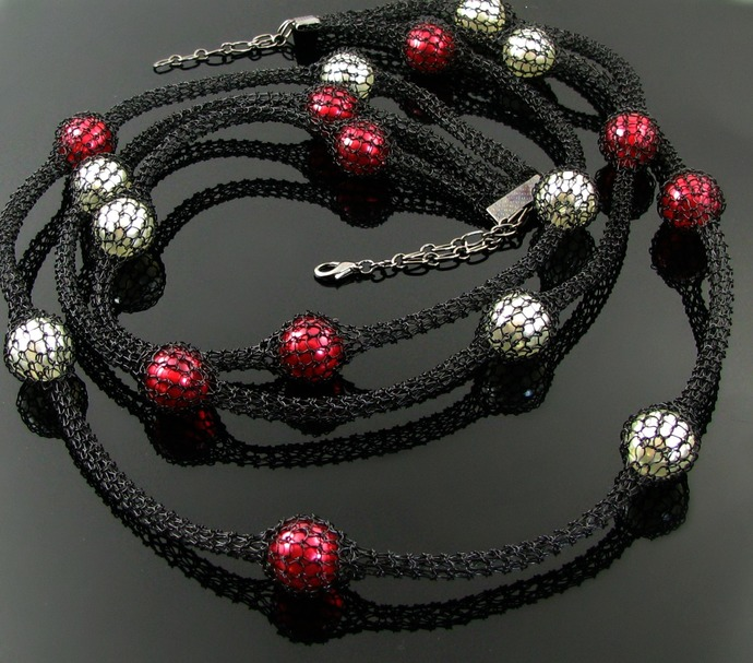 Long black wire knit necklace with white and red glass pearls