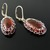 Fine silver wire knit earrings with faux amber cabochons
